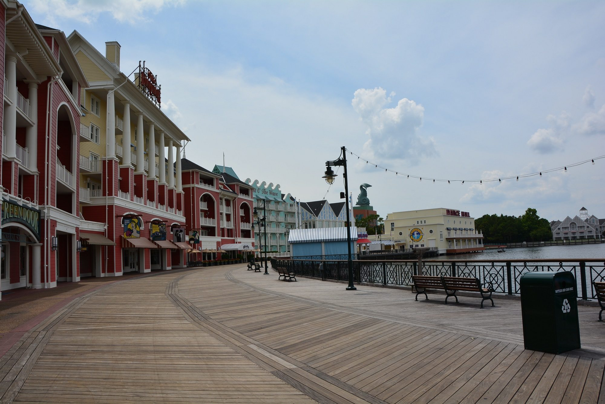 Stringed lights and brightly colored buildings line the boardwalk at Disney's Boardwalk Villas