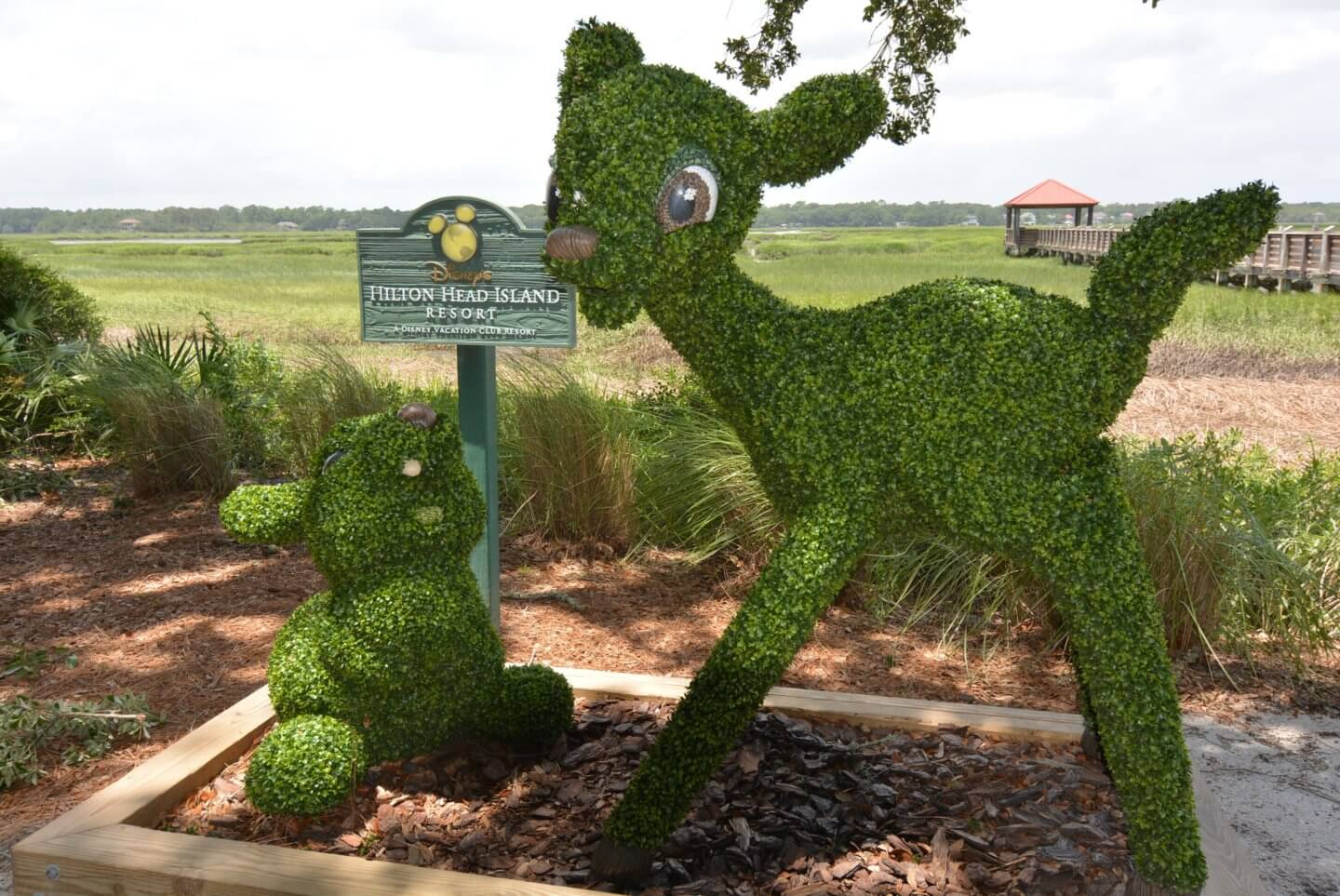 Bambi and Thumper topiary statues with a Disney's Hilton Head Island Resort sign.