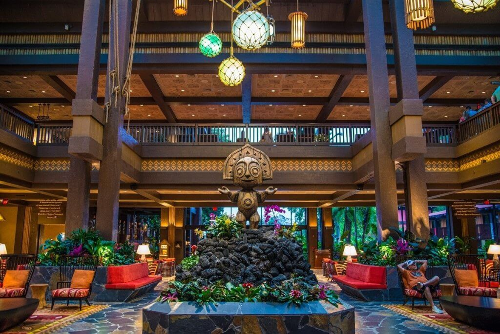 Disney Vacation Club Polynesian Village Resort lobby statue and decorated sitting area.