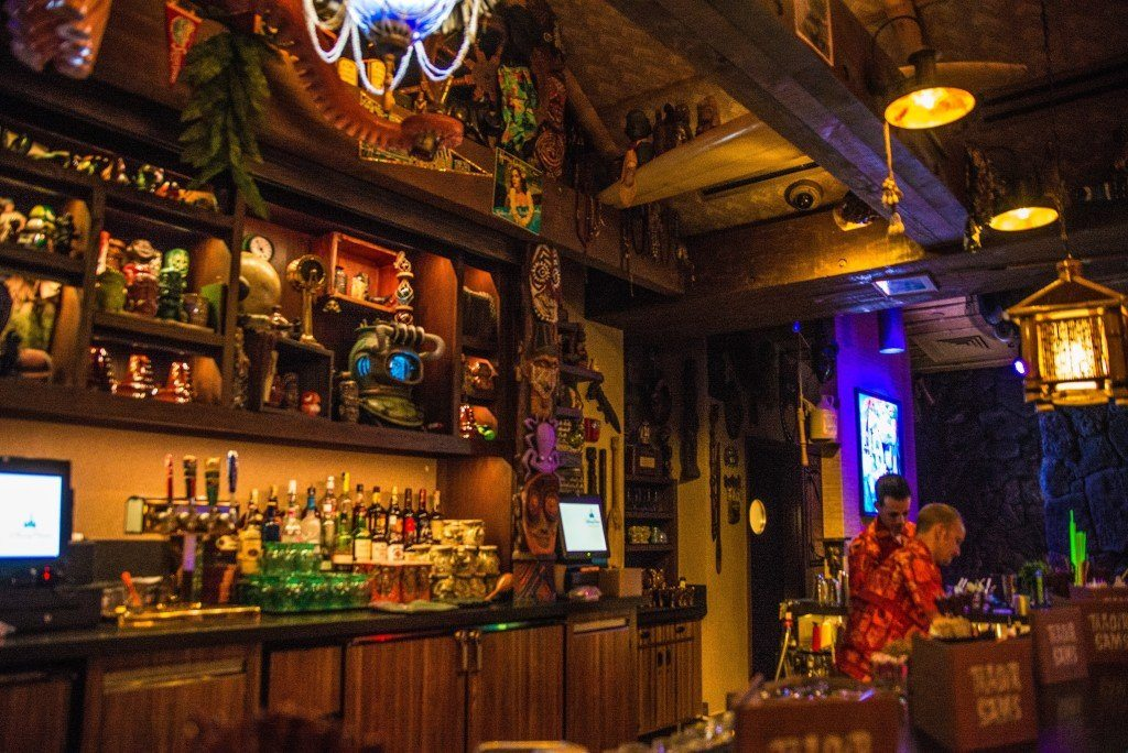 A bartender makes a drink at Trader Sam's bar at Disney's Polynesian Resort