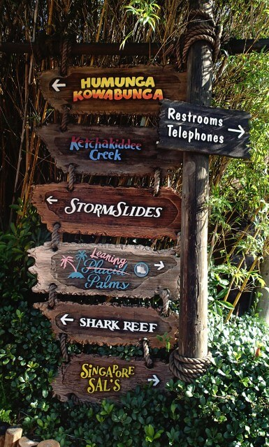 Typhoon Lagoon signs pointing in different directions to the attractions